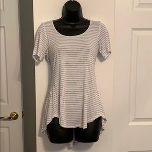 Tee shirt with scoop back and pleated shirt tail.